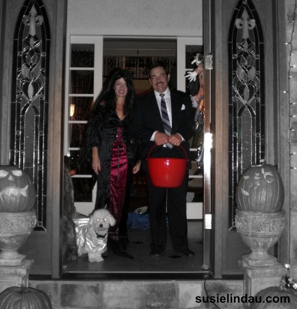 morticia and gomez and dog