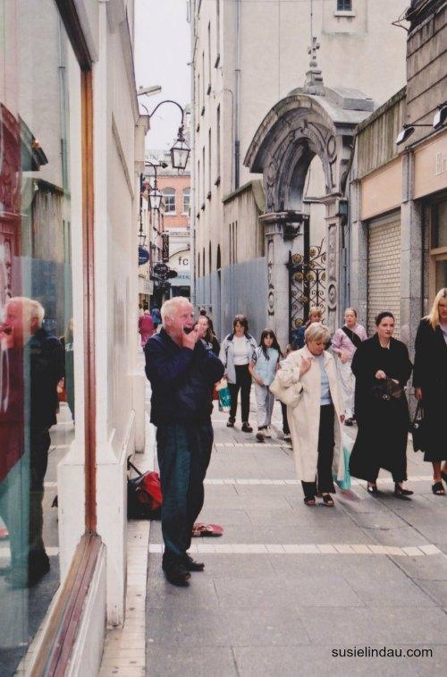 Man playing Irish flute in Dublin Ireland