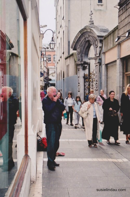 Man playing Irish flute in Dublin Ireland