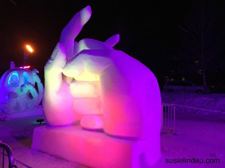 fist bump snow sculpture