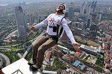 BASE jumper on ledge of building