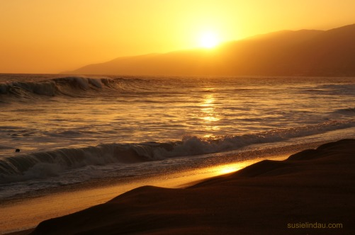 Solid gold summer sunset at Malibu Beach