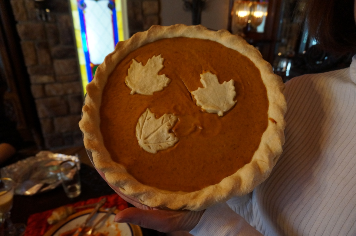 pumpkin pie with maple leaves