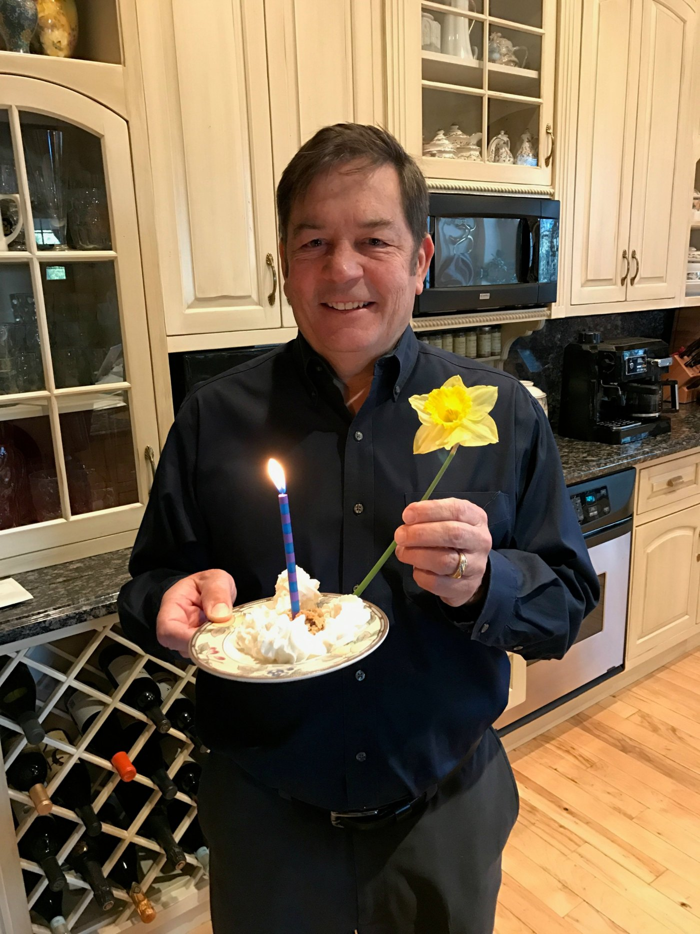 Husband with cake, candle and flower for my birthday