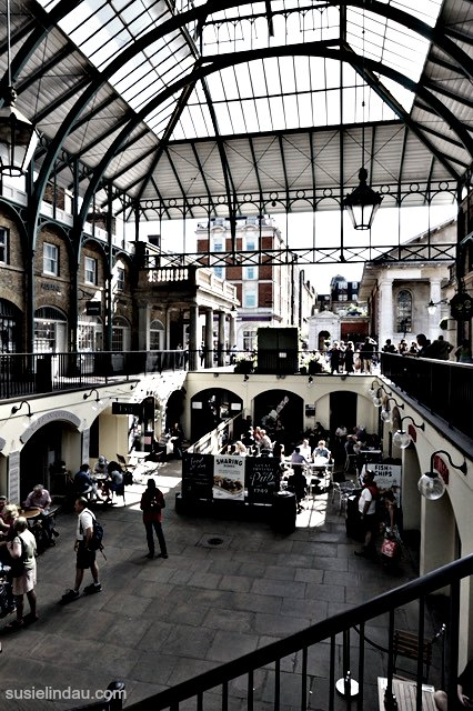 Inside Covent Garden while enjoying the architecture