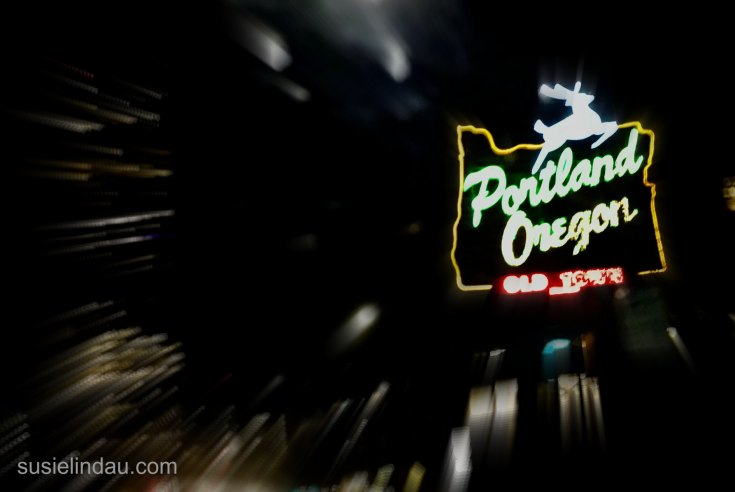 Portland Oregon sign with reindeer lit up at night