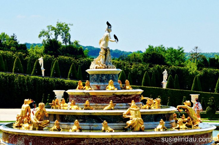 The best of Versailles - Birds perch on gold leaf fountain at Versailles