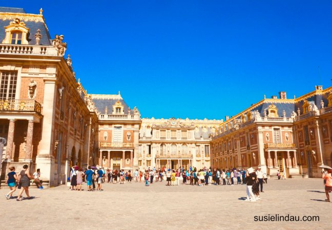 The Best of Versailles Castle sparkling in gold gilt, tourists admire the French architecture