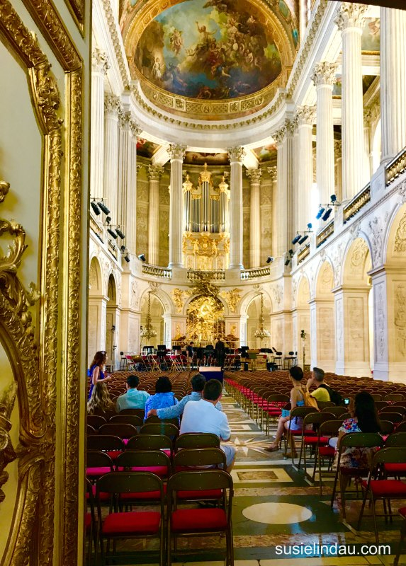 The Best of Versailles, A smallish chapel in Versailles as tourists sit and admire the painted ceilings and gold leaf ceilings