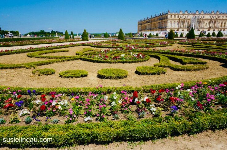 The Best of Versailles, formal flower gardens with the castle in the background