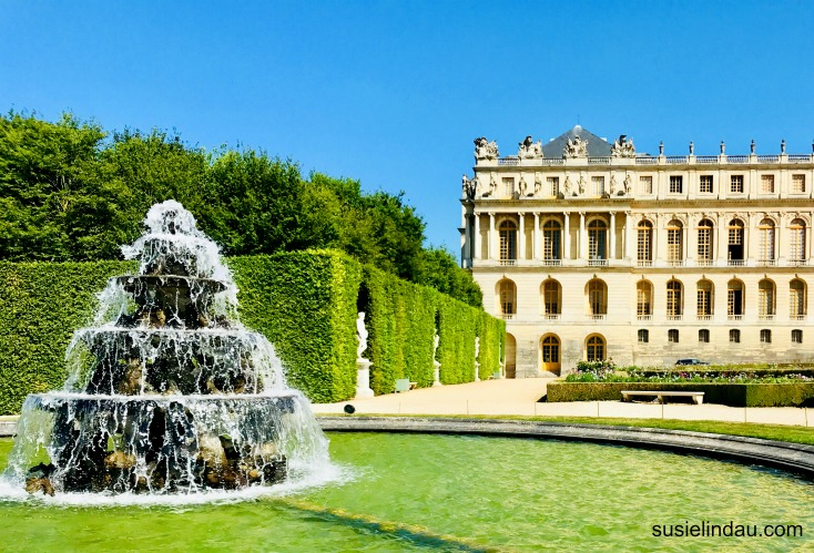The Best of Versailles, outdoor fountain with castle in background