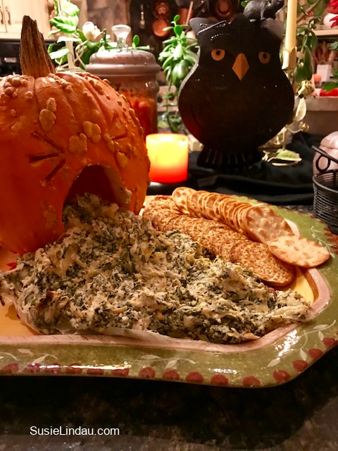 Puking Pumpkin artichoke dip. Click for more Halloween party ideas! Halloween food and snacks, treats, Food and recipes, Halloween parties, Spooky decor, #Halloween #halloweenparty #halloweenideas #food #snacks