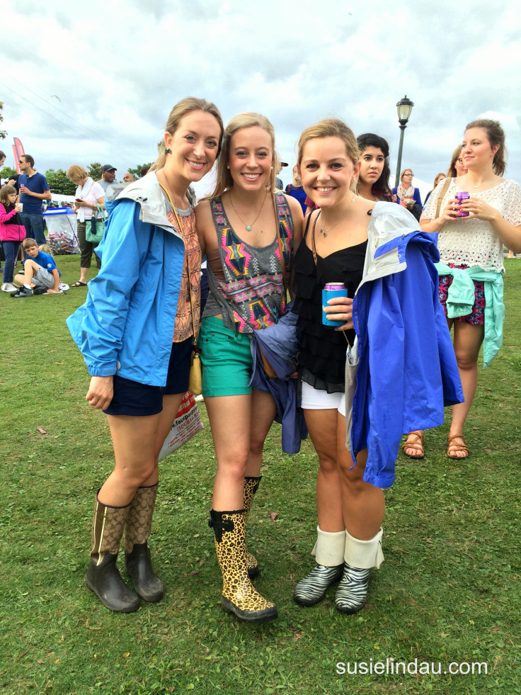 Girls with fancy rubber boots at an outdoor concert in New Orleans. Click for things to do in the French Quarter!