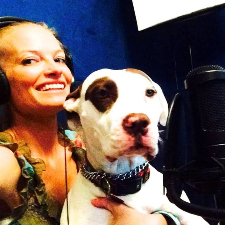 August McLaughlin Via Girl Boner Radio with her dog