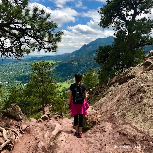 Overlooking the Flatirons from Mount Sanitas. Click for photos and a guide to one of Boulder's best hikes! Outdoor adventures | Boulder travel | Colorado vacations | Colorado hikes | Boulder hikes | Travel North America #Colorado #Coloradohikes #Boulder #Bouldertravel #outdooradventures