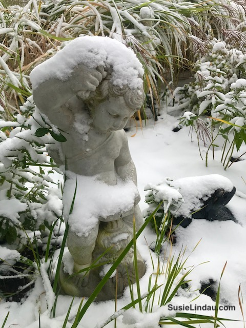 A snow covered cupid