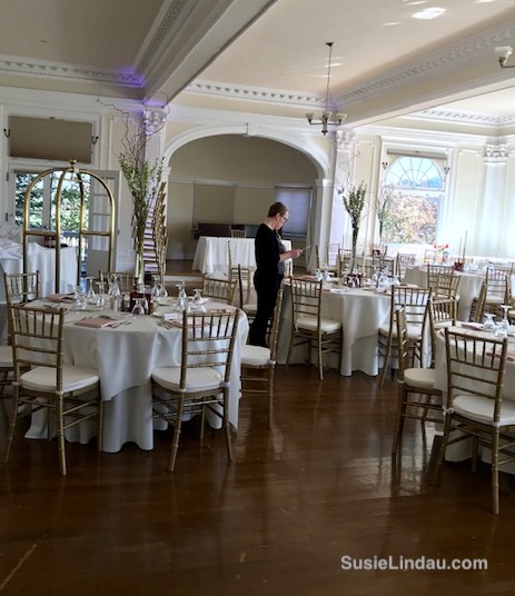 tables set in the piano room for a white wedding