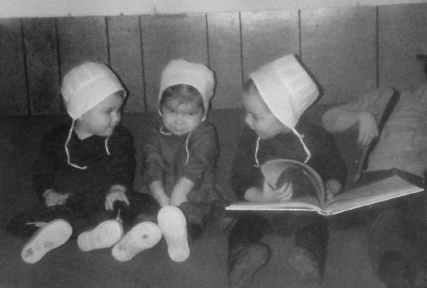 Meg Delagrange and Regina Bauman little Amish girls in hats