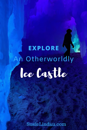 Explore an Otherworldly Ice Castle! A pinterest pin with a woman walking through and icy blue room