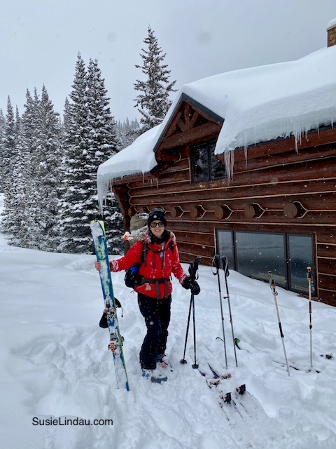 Francie's Cabin in Breckenridge Colorado, susie holding skis in the snow