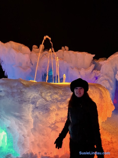 Ice Castles 19 fountain in hues of orange, pinks and purple