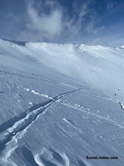 Skiing Inspiration Bowl. Cornices at the top of the peak with dramatic cloud formation