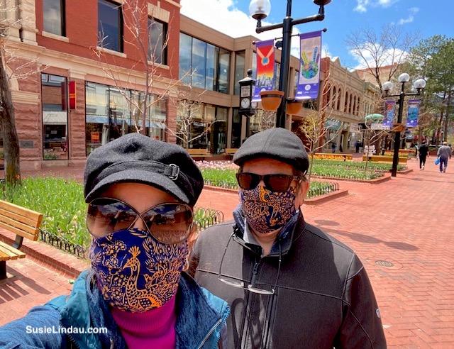 Susie Danny wear masks on empty Pearl Street in Boulder, Colorado