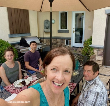 A family celebration after paddleboarding an outdoor picnic and selfie with the Lindau's