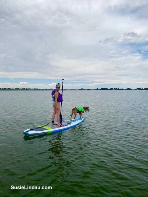 Courtney and her dog, Lady paddleboarding on Union Reservoir in Longmont, Colorado