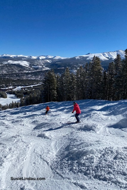 Skiers on a bump run in Breckenridge