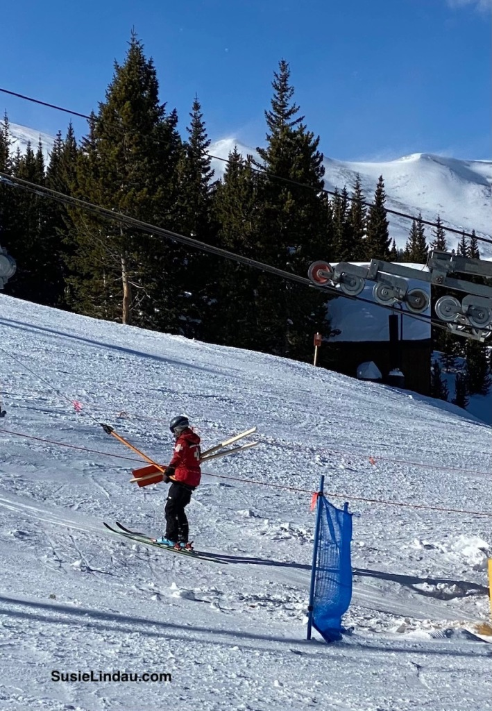 Ski patrol riding up the T-bar at Breckenridge